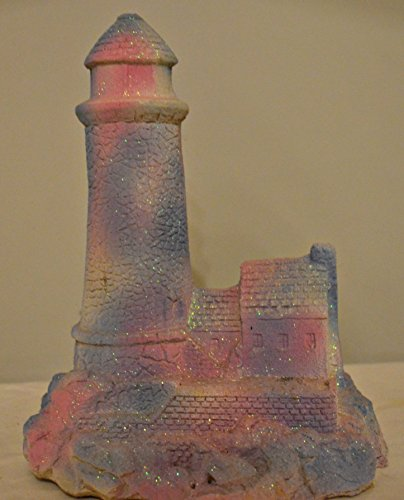 Aquarium Safe, Hand Made Out of Sand, Weather Resistant Painted Pink, Purple, and White Covered in Glitter Fantasy Princess Lighthouse. Made As an Aquarium Decoration or Just a Simple Bedroom Decoration for Girls. Measurements Are 8 X 5 1/2 X 10
