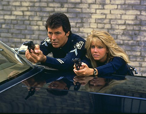 james-darren-and-heather-locklear-in-tj-hooker-pointing-guns-by-police-car