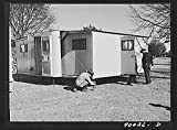 1941 Photo Palace mobile home. Expansion trailer for emergency defense housing demonstrated in Washington tourist camp. Washington, D.C. Location: Washington D.C.