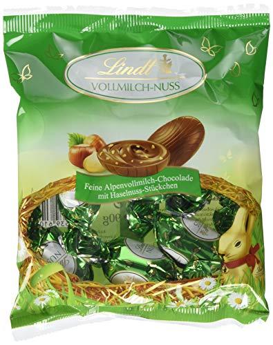 Lindt Doppeldreh Schokoladen Eier, feine Alpenvollmilch-Chocolade mit Haselnuss-Stückchen im Beutel, 22er Pack (22 x 90 g)