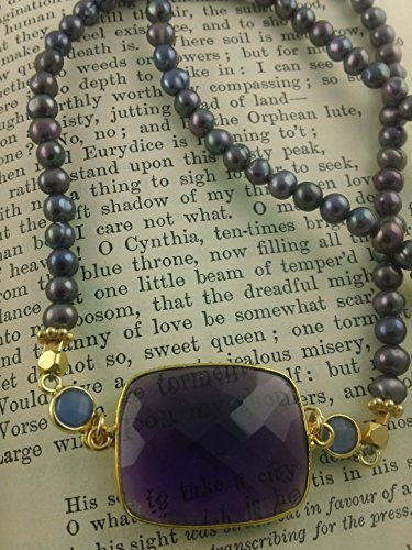 Peacock pearls accented with a stunning Amethyst Rectangle and two small coins of blue onyx wrapped in Vermeil