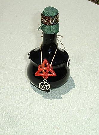 Amazon.com: Botella de vidrio negro Caldero Avon pequeña con ...