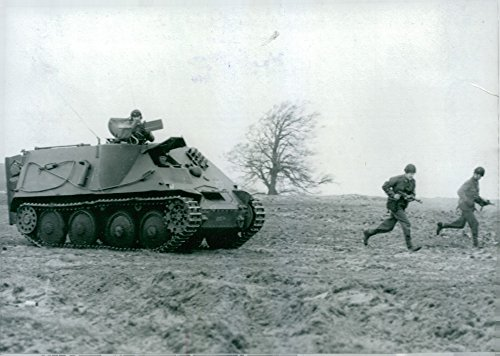 Vintage photo of Swedish defense presents new armored tracked vehicles in combat shooting in eastern -