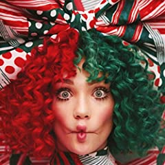 """Sia's first ever Christmas album. The collection of original holiday songs was written by Sia and Greg Kurstin. The album's lead single, """"Santa's Coming For Us,"""" has several counterparts on the album including other festive songs like """"Candy ..."""