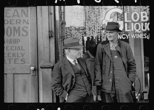 Photo: Men talking in front of saloon on lower Douglas Street,Omaha,Nebraska ()