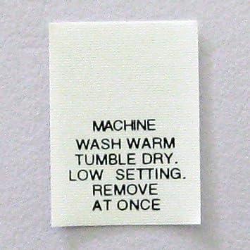 Lavage En Machine A Chaud Passe Au Seche Linge Vetement De