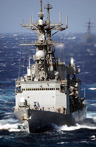 From aboard USS Kitty Hawk (CV 63) Oct. 29, 2002The destroyer USS Paul F. Foster (DD 964) approa