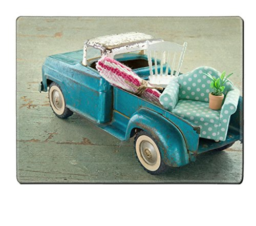 MSD Placemat IMAGE ID 19979236 Old vintage toy truck packed with furniture moving houses concept