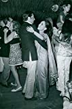 Vintage photo of Dewi Sukarno dance with the man in Portugal, 1968.