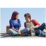 David & Fatima Cameron Van Hoy as David Isaac and Danielle Duvale as Fatima Aziz Sitting Next to One Another Smiling 8 x 10 Inch Photo