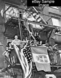 1943 Italian Americans gather on apartment building fire escapes waving flags a8
