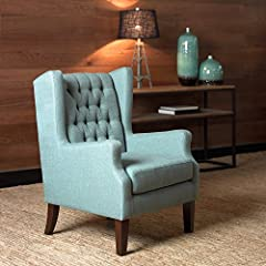 This classic wing chair with its button tufted detailing and sloped arms adds a casual twist with its pool Blue casual woven fabric. Leg assembly required.