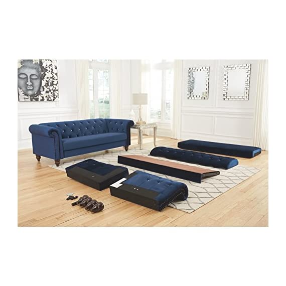 Ashley Furniture Signature Design - Malchin Casual Upholstered Sofa with Faux Crystal Button Tufting - RTA Sofa in a Box - Navy - CHESTERFIELD SOFA: Feeling star struck yet? We are with this timeless Chesterfield design. Chic detailing such as the rolled arms and diamond tufting provide that luxe finish you crave STYLISH COMFORT: High-resiliency foam cushions are wrapped in supple polyester with faux crystal button tufting. Designed with black nickel nailhead trim and exposed feet with a faux wood finish DEEP NAVY: Fashionistas rejoice—elevated style is brought to the forefront with this elegant shade of blue in your living room - sofas-couches, living-room-furniture, living-room - 51cToitCrjL. SS570  -