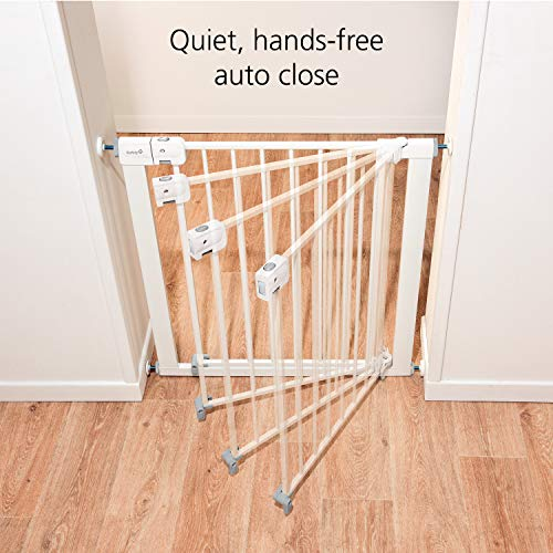 51cVWdGOuNL Safety 1st Easy Install Auto-Close Baby Gate with Pressure Mount Fastening, White    Create child-friendly spaces in your home or on-the-go with the Safety 1st Easy Install Auto-Close Baby Gate with Pressure Mount Fastening. This sturdy baby gate can be opened with one hand and adjusted to fit doorways and openings ranging from 29 to 38 inches wide. Pressure-mounted installation requires no tools, drilling, or hardware and allows for setting up this baby gate quickly and easily in doors or pass-through areas. A magnetic latch causes the baby gate to close and lock automatically, and the SecureTech indicator tells you at a glance that the gate is secure. Easily create a safe space for children in your home or when visiting family and friends by using this 28-inch-high adjustable baby gate in doorways, hallways, staircases, and more. Includes one pressure-mounted baby gate. JPMA-certified baby gate meets ASTM standards for safety and includes a one-year limited warranty. Safety 1st believes parenting should have fewer worries and more joyful moments. As the first and only leader in child safety, Safety 1st is here to give you peace of mind so you can spend less time worrying and more time enjoying every first you experience with your child. To clean, wipe with a damp cloth and dry.