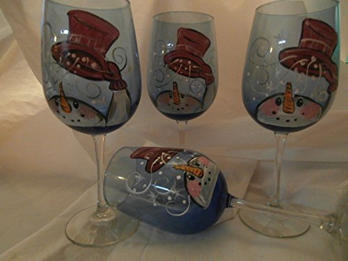 Hand painted blue goblets painted in whimsical snowman and top hat. . Set of 4. 20 ounces each.