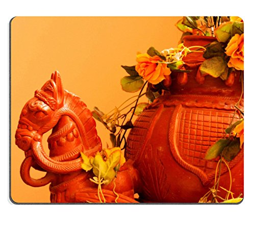 msd-mousepad-image-22934375-lle-clay-horse-with-a-chariot-full-of-flowers-set-against-an-orange-wall