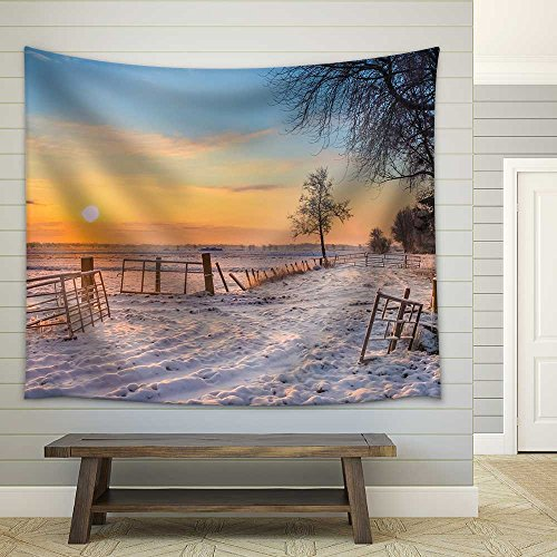 Gates and Fences in Winter Landscape with Snowy Fields and Blue Sky in Drenthe Netherlands Fabric Wall