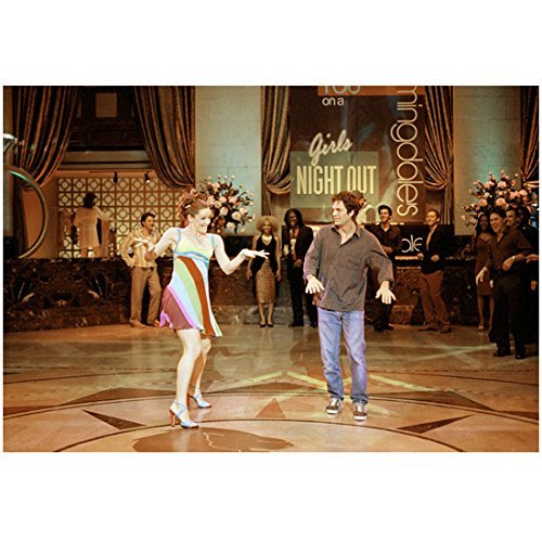 13 Going on 30 Jennifer Garner as Jenna Rink Wearing Striped Dress Hands Up and Out Dancing Next to Mark Ruffalo as Matt Flamhaff Wearing Jeans and Button Up in Middle of Dance Floor Girls Night Banner in Background 8 x 10 Photo