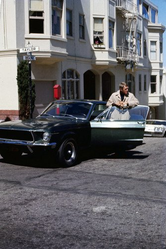 (Steve McQueen in Bullitt classic Ford Mustang GT 390 on set San Francisco intersection of Broadway & Taylor. Great rare image of the legendary star and ca)