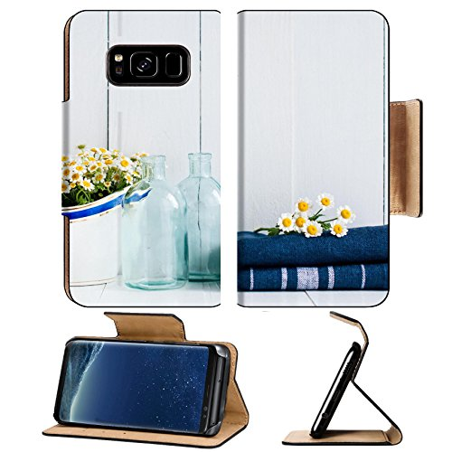 Liili Premium Samsung Galaxy S8 Plus Flip Pu Leather Wallet Case Chamomile flowers in vintage ceramic gravy boat glass bottles and navy linen towels on white wooden background home kitchen (Art Gravy Boat)