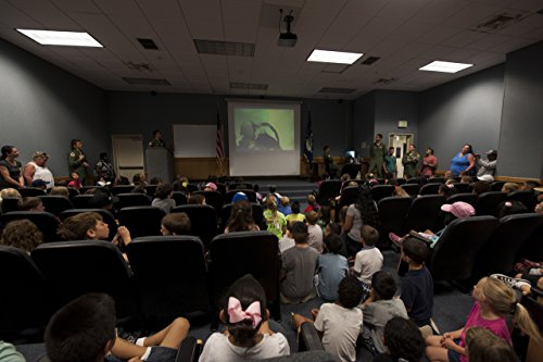 First grade students from Bechtel Elementary School watch a video about fighter jets and