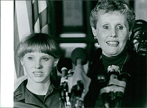 Vintage photo of A joyful Mrs. Judith Dozier, with her daughter Cheryl, attending a press conference. ()