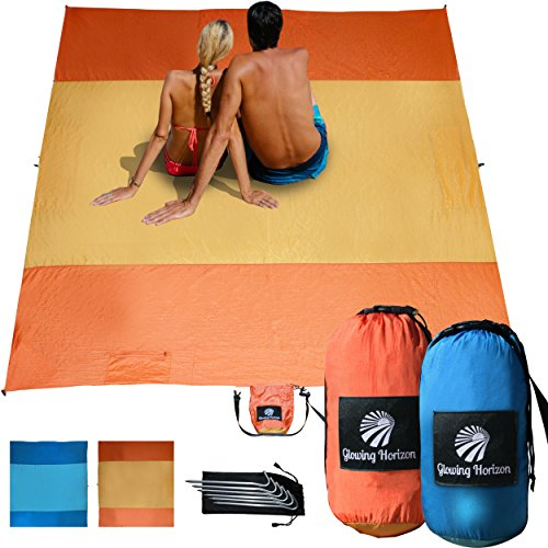 Glowing Horizon Sand Free Beach Blanket Sand Proof/Picnic Blanket- Extra Large 9' x 10' in Compact Bag- 8 Hidden Sand Pockets + Metal Stakes + Storage Pocket, Lightweight, Parachute Nylon (Orange)