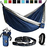 Navy and Grey Flagship-X Double Hammock fits 2 adults. Comes with everything including hammock, tree straps, carabiners, and a fire-starting survival paracord bracelet.