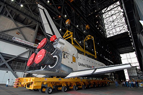 - Space shuttle Atlantis rolls into the Vehicle Assembly Building at Kennedy Space Center Poster Print by Stocktrek Images (34 x 22)