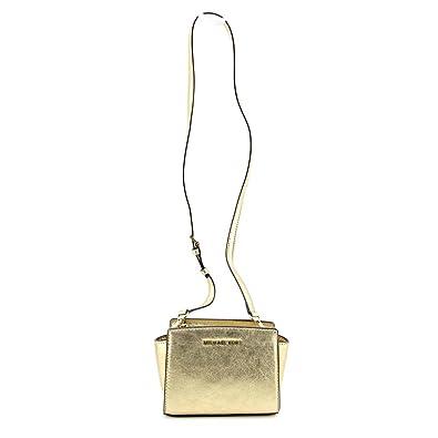 9c20bef101e5 Image Unavailable. Image not available for. Color  Michael Michael Kors  Selma Mini Messenger Bag Pale Gold
