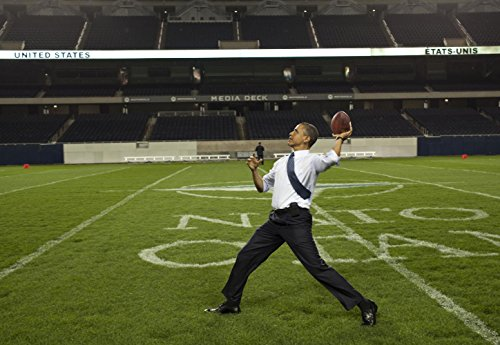 Gifts Delight Laminated 34x24 Poster: President Barack Obama Throws a Football
