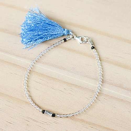 - Crystal beads bracelet and silver oxidized sticks at the center with blue color tassel on sterling silver lobster clasp closer