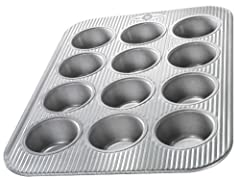 The USA Pan 12 Cup Cupcake and Muffin Pan measures a full 2.75 x 2.0625 x 1.375 inches* in each cup. This pan allows you to make the perfectly sized on the go muffins or cupcakes for birthday parties. Indulge in bakery quality chocolate and v...
