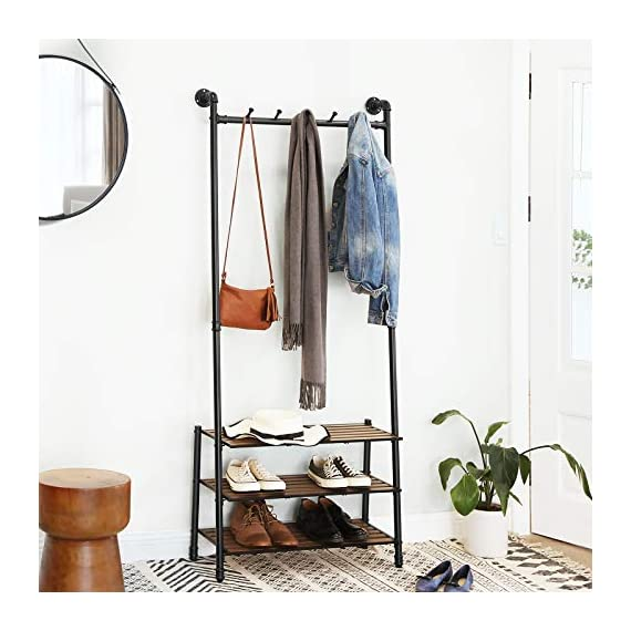 "VASAGLE Coat Rack with Shoe Rack, Industrial Pipe Style Hall Tree, Angled Coat Stand for Hallway Entryway, Standing Against The Wall, Bolt Hooks and Slat Shelves, Stable Metal Frame, Black URCR75BX - INDUSTRIAL STYLE IS IN! Angled black pipes, slat shelves, bolt hooks-a hall tree overflowing with industrial accents makes a unique staple in your hallway while providing a convenient drop-off spot on your way in or out PROP AGAINST THE WALL: A blank wall is all it needs to create an attractive display, and the jackets you throw on it will complete its standout look; prop it against the wall for a stable stand, or attach it to the wall with the included hardware FROM HEAD TO TOE: With a 69.7"" high slanted design tying the whole stand together, it packs plenty of storage without taking too much space, catching hats and coats on the 5 hooks and hosting shoes on the 3 shelves - hall-trees, entryway-furniture-decor, entryway-laundry-room - 51d9Q 3n7zL. SS570  -"