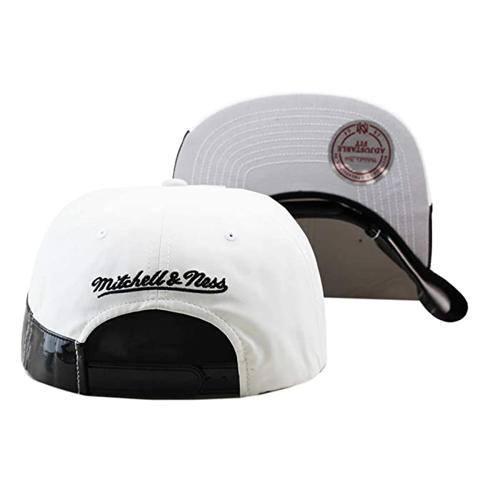 release date: 3be40 8832c Amazon.com   Mitchell   Ness Chicago Bulls Snapback Hat Cap White Faux  Leather Black Patent Leather   Sports   Outdoors