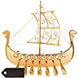 This carefully crafted figurine is plated in 24K Gold which enhances the slender design of this collectible treasure. An integral part of the piece is the stunning crystals that truly bring it to life. Sturdily designed and with a beau...