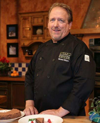 Chef Revival J030BK Chef-Tex Poly Cotton Traditional Long Sleeve Chef Jacket with Chef Logo Button, 5X-Large, Black (Clothing Revival Chef)