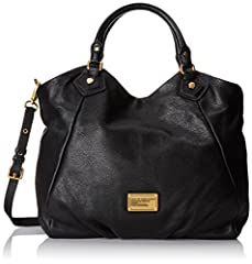 This pebbled leather handbag features a logo plate at the front and pleating at the bottom. Spring-lock strap gathers top. Antiqued gold hardware. Double rolled handles and detachable, adjustable shoulder strap. Magnetic main compartment clos...