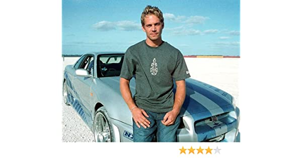 Paul Walker Iconic Pose With Nissan Skyline Gt-R 11x14 HD Aluminum Wall Art at Amazons Entertainment Collectibles Store