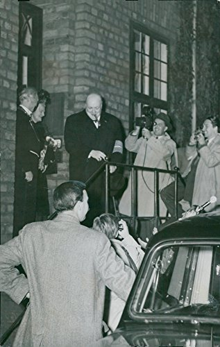 - Vintage photo of Winston Churchill comes out with a smile and cigar in a mouth from the university with the arm of the Danish Liberation Movement. In the door, rector magnicicus H.M. Hansen, the press is waiting outside