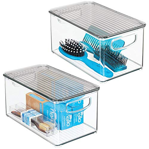 """mDesign Plastic Bathroom Storage Bin with Handles, Lid - Holds Soap, Body Wash, Shampoo, Lotion, Conditioner, Hand Towels, Hair Accessories, Body Spray, Mouthwash - 10"""" Long, 2 Pack - Clear/Smoke Gray"""
