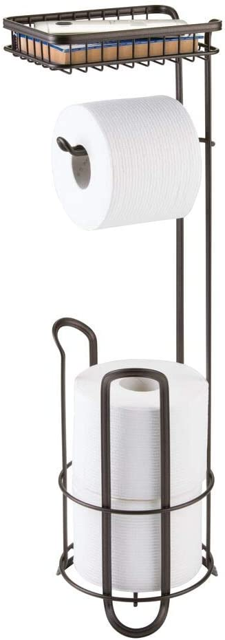 mDesign Toilet Roll Holder - Free Standing - No Drilling Necessary - Loo Roll Holder for The Bathroom - Toilet Paper Holder Stand - Added Space for Brush - Bronze