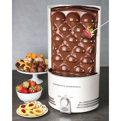 Nostalgia Electrics Auger-Style Chocolate Waterfall with Heated Base and Turn-dial Controls Perfect to Dip Cakes, Fruits and Marshmallows ()