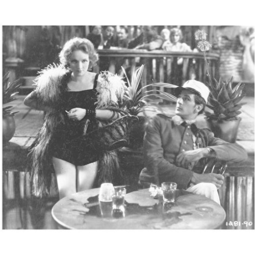Marlene Dietrich 8 Inch x 10 Inch Photo Witness for the Prosecution The Blue Angel Destry Rides Again B&W Holding Basket on Arm Next to Man Sitting at Table kn