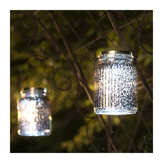 GIGALUMI Solar Powered Mercury Glass Mason Jar Lights, 2 Pack Hanging Solar Laterns Table Lights for Garden, Patio, Backyard.(Ideal Gift) - Crafted of glass with a silver mercury finish, our solar-powered lantern features a premium white LED lights that make the lamp look fantastic at night! Multiple Uses: 2 ways to install these solar lights, Hang or stand on a flat surface Solar powered Mason Jar Lights: No wiring. No AC current. Store energy from sun rays during daytime and automatically turn on at night. Illuminating for up to 8 hours with a full charge - patio, outdoor-lights, outdoor-decor - 51djlzYDYkL. SS570  -