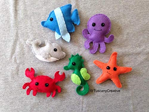 - Ocean Creature Toys, Includes a Dolphin, Fish, Octopus, Starfish, Seahorse & Crab