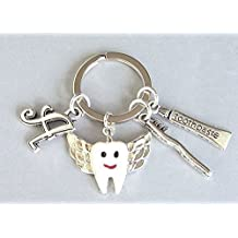 Personalized tooth fairy keyring with wings, toothpaste, brush, and initial charms