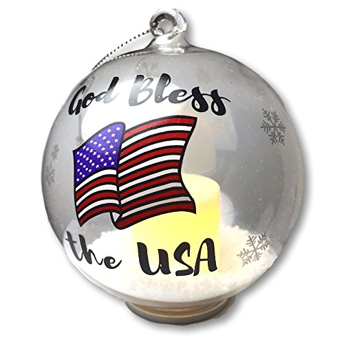 BANBERRY DESIGNS Patriotic Christmas Ornament - Glass Ball Ornament with God Bless The USA - Light Up Ornament with a LED Candle and Artificial Snow Inside - Red White and Blue American Flag Design -