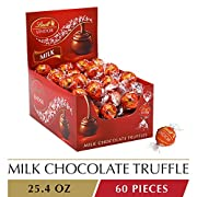 Experience pure bliss with irresistibly smooth Lindt LINDOR Milk Chocolate Truffles. LINDOR truffles are the perfect way to turn everyday events into special occasions. Whether celebrating with coworkers, relaxing with family, sharing a meal with fri...