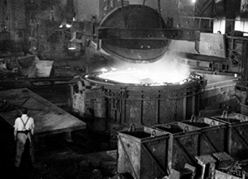 Posterazzi High angle view of foundry worker working in steel mill Poster Print (18 x 24) from Posterazzi